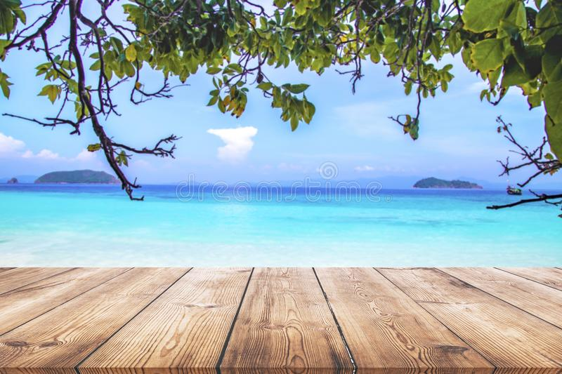 Wood table with blue sea and sand beach background royalty free stock images