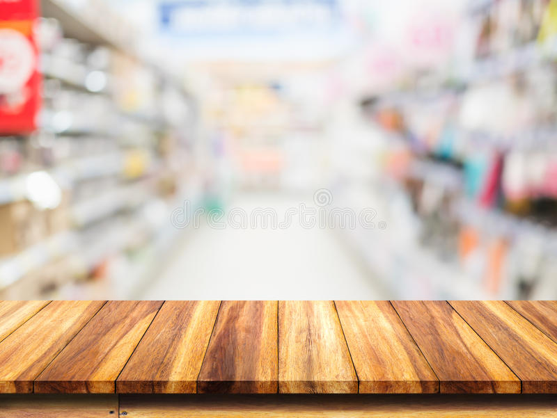 Wood table on blur supermarket background. royalty free stock photo