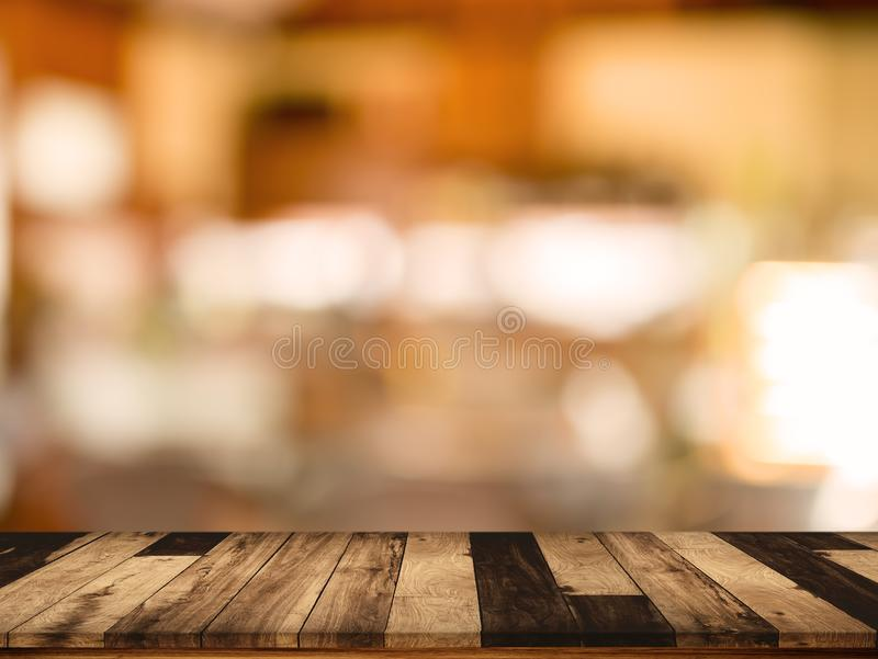 Wood table with blurred interior in cafe background. Empty top of wood table with blurred interior in cafe background royalty free stock image