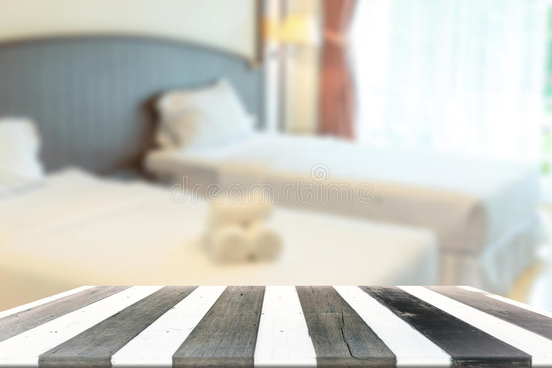 Wood table and blurry bed room in background. Wood empty table for display product and blurry bed room in background stock images