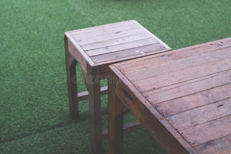 Wood table and chair on outdoor royalty free stock images