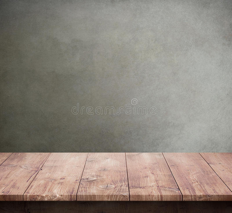 Wood table with concrete texture background. Wooden table with concrete texture background stock photography