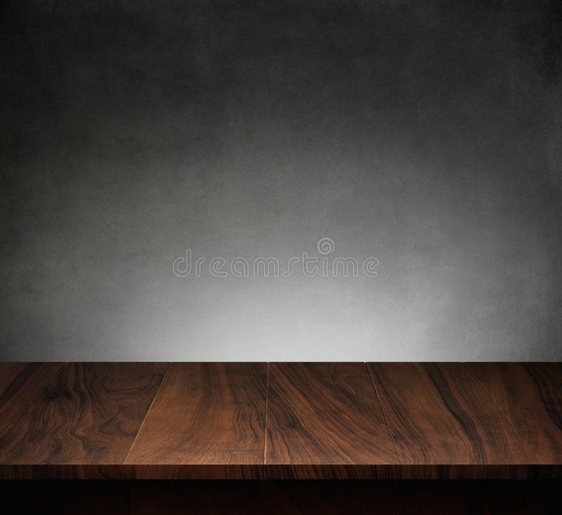 Wood table with dark concrete texture background stock photography