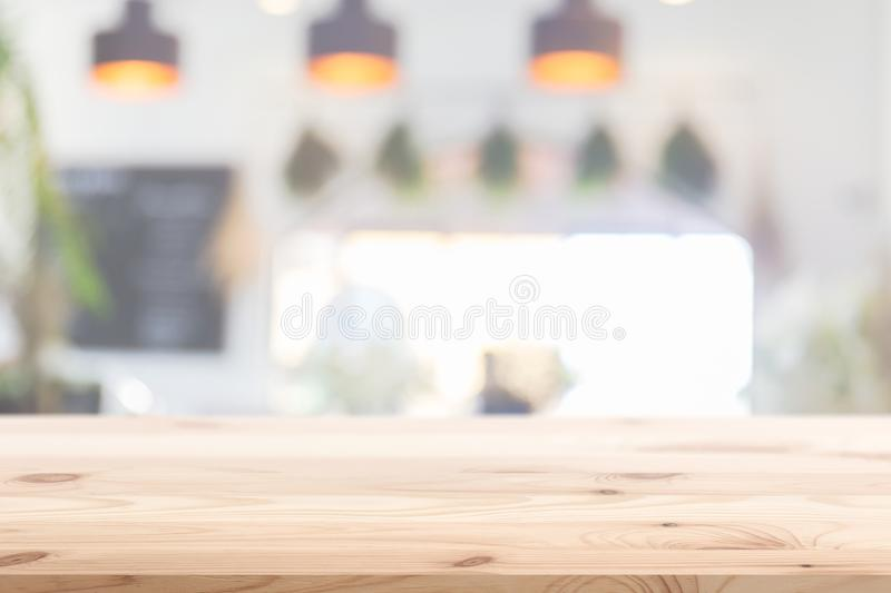 Wood table foreground with blur home cafe kitchen background stock image