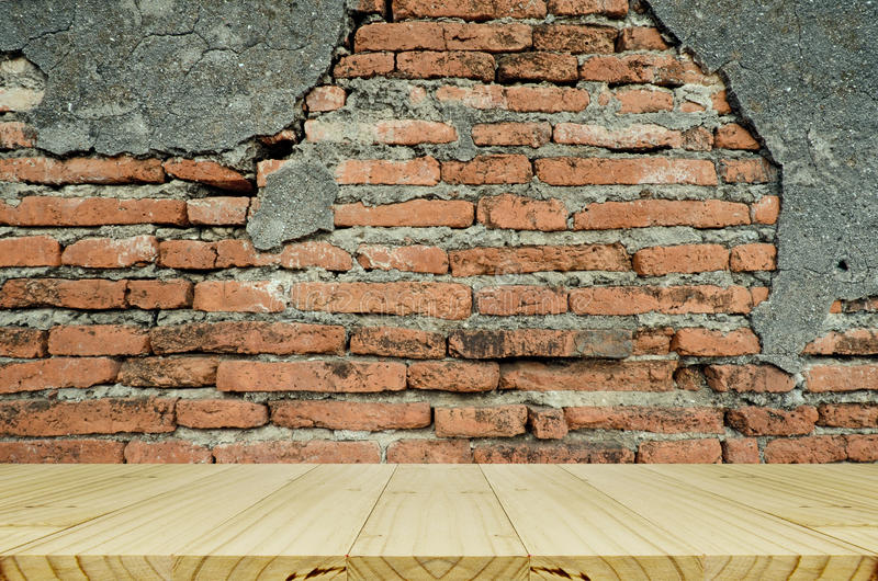 Wood Table With Hipster Brick Wall Background. stock image