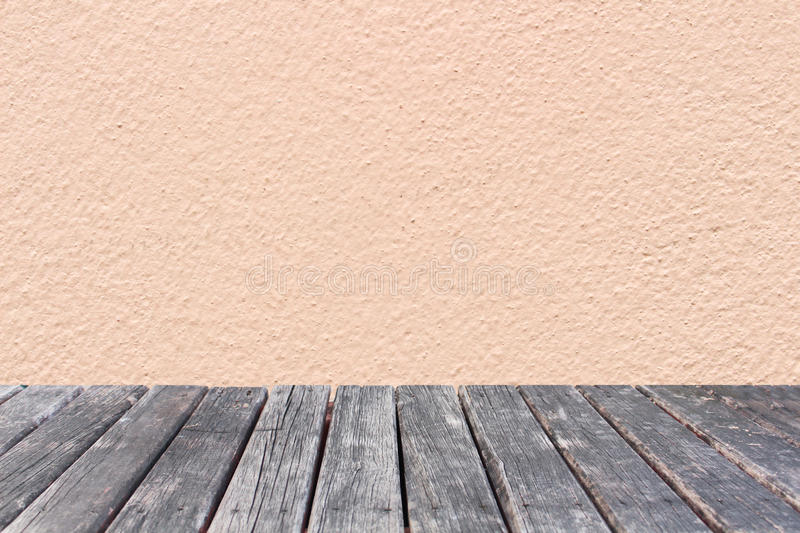 Wood table on pink wall concrete background royalty free stock image
