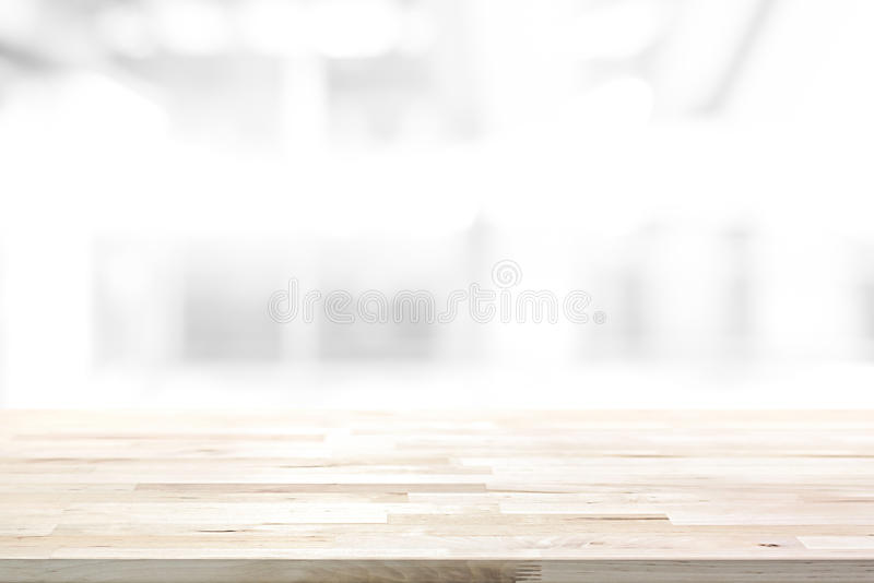 Wood table top on abstract blur white background. Can be used for display or montage your products royalty free stock photo