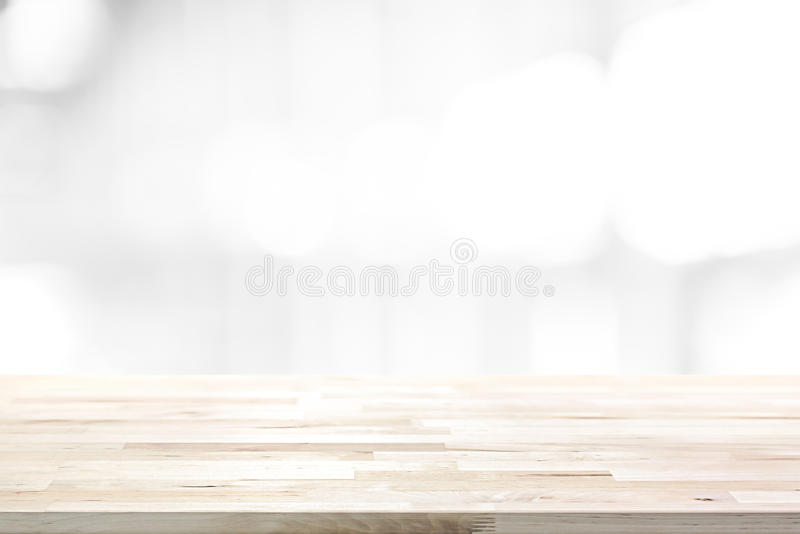 Wood table top on abstract blur white background. Can be used for display or montage your products stock photos