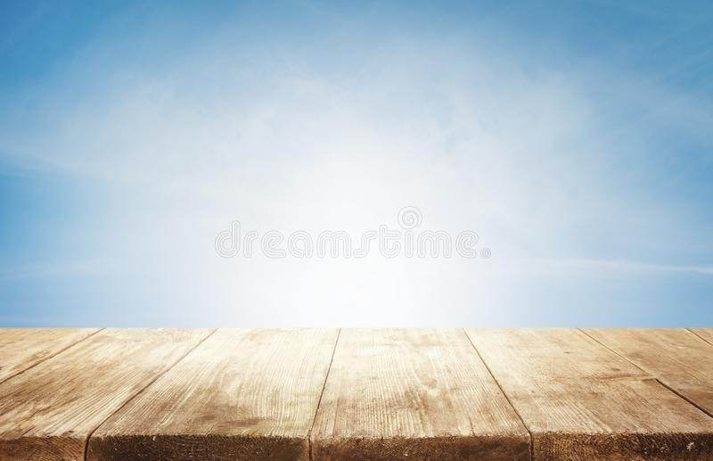Wood Table Top Background, Empty Wooden Desk over Blue Sky royalty free stock photos