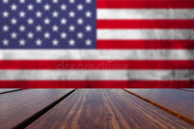 Wood Table Top Background with USA national flag. royalty free stock image