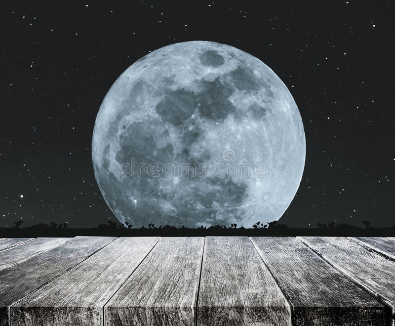 Wood Table Top With Beautiful Full Moon At Night With