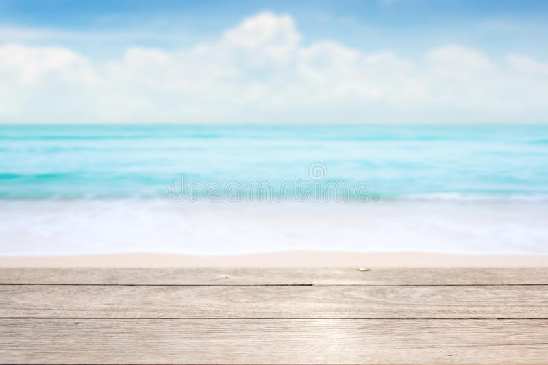 Wood table top on blue sea & sky background stock images