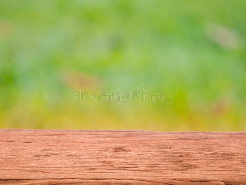 Wood table top on blur abstract green from garden.For montage product display or design key visual layout. royalty free stock photo