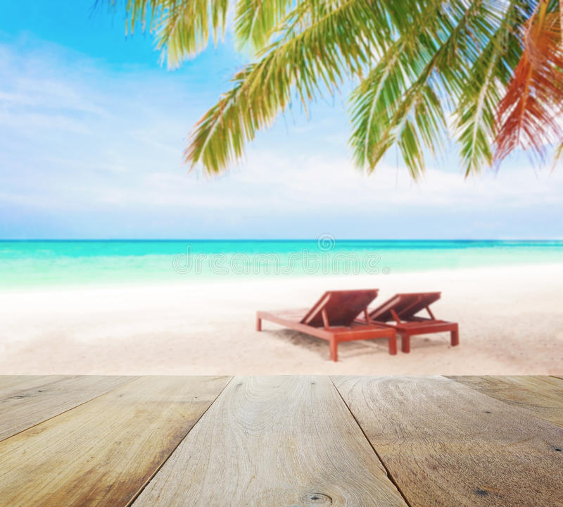 Wood Table Top On Blur Beach Background With Beach Chairs