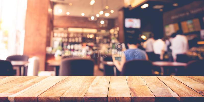 Wood table top with blur coffee shop,cafe background. For montage product display or design key visual layout royalty free stock photos