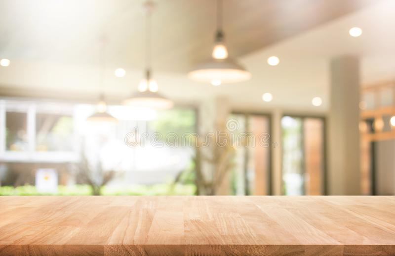 Wood table top with blur coffee shop or cafe,restaurant. Background.For montage product display or design key visual layout stock image
