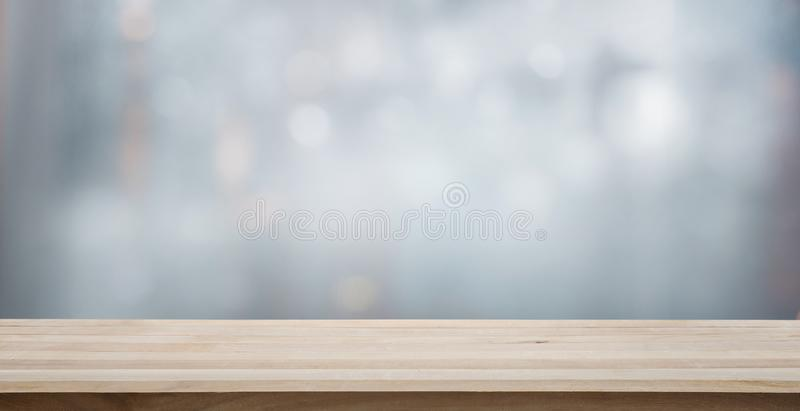 Wood table top on blur glass window wall building. Background.For montage product display or design key visual layout background stock photos