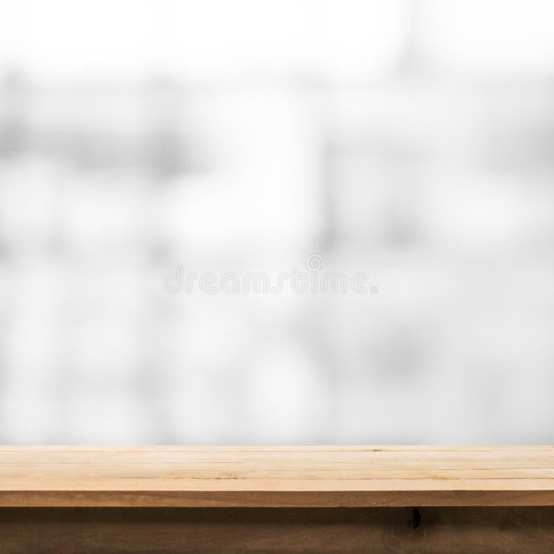Wood table top on blur glass window wall building. Background.For montage product display or design key visual layout background royalty free stock photo