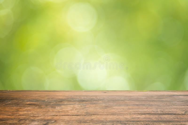 Wood table top on blur green abstract background from nature royalty free stock photos