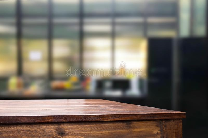 Wood table top on blur kitchen or cafe room background .For mont. Age product display design key visual layout stock photography