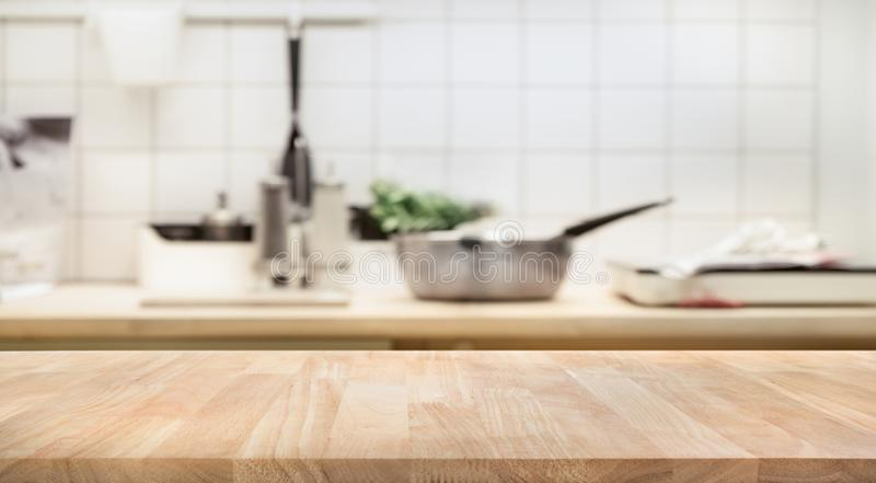 Wood table top on blur kitchen room background royalty free stock photos