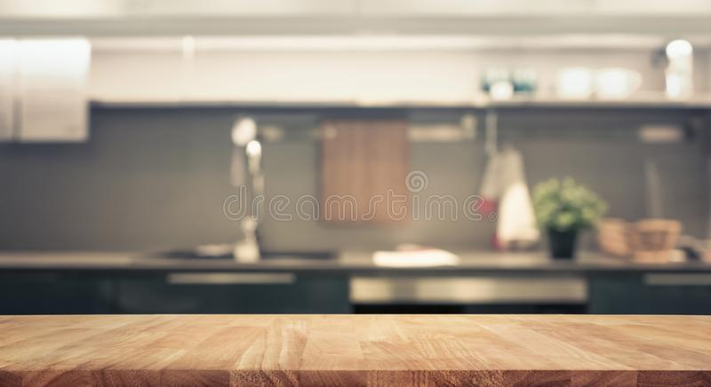 Wood table top on blur kitchen room background stock photos
