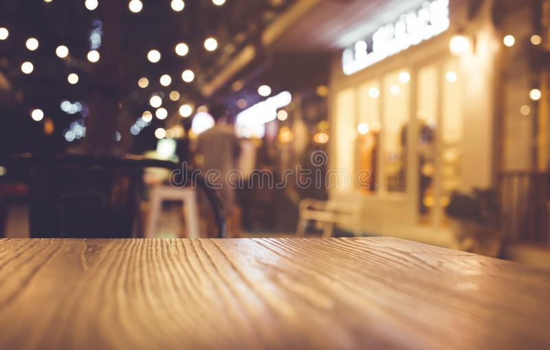 restaurant table top lighting. Download Wood Table Top With Blur Of Lighting In Night Cafe Restaurant Community Stock Image -