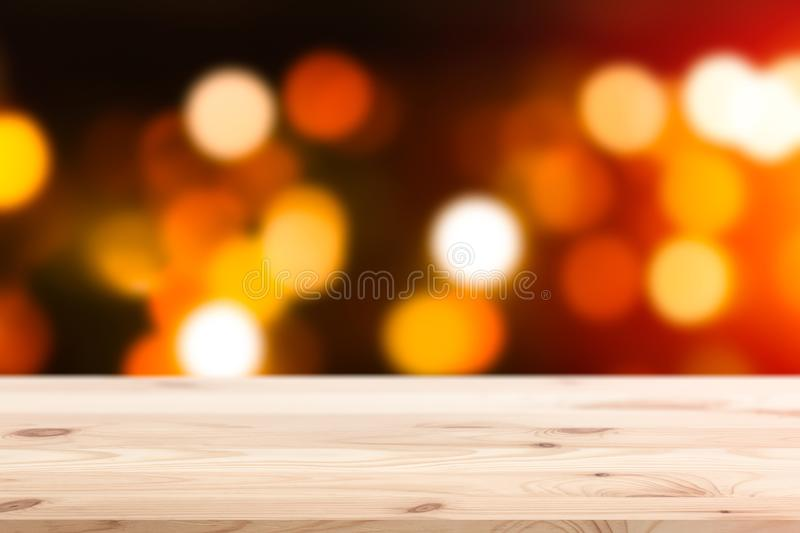 Wood table top with blur warm light bokeh abstract royalty free stock image