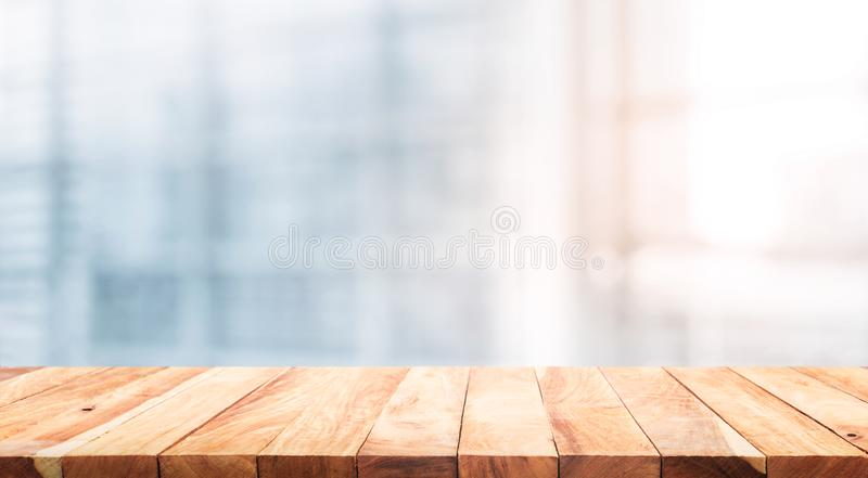 Wood table top on blur white glass window background form office. Building.For montage product display and design key visual layout royalty free stock photography
