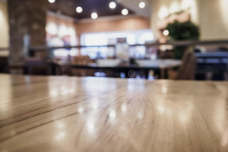 Wood table top with blurred cafe restaurant stock photos