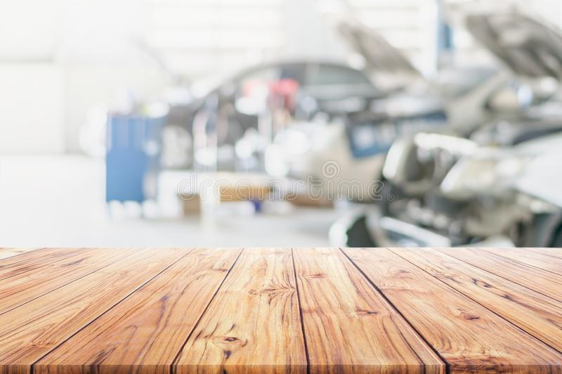 Wood table top on blurred Car Repair Services Center Blurred use us automobile maintenance technician repair background. Used us montage display or products stock photography
