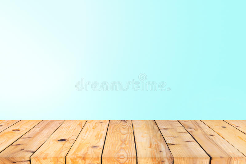 Wood table top on cyan wall stock image of