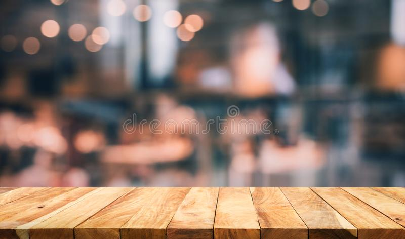 Wood table top with light gold cafe,restaurant background. /selective focus royalty free stock photo
