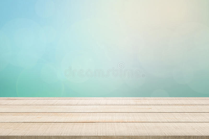 Wood table top panel on turquoise background royalty free stock images