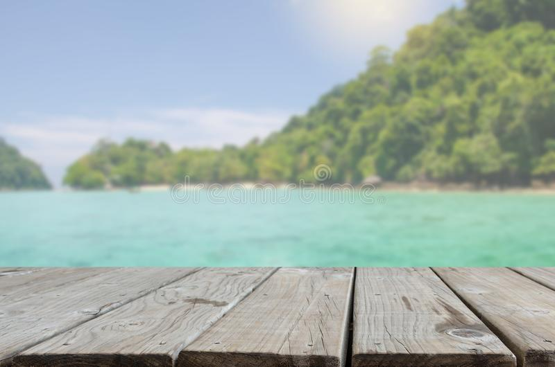 Wood table top sea and beach stock image