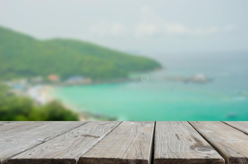 Wood table top sea and beach stock photo