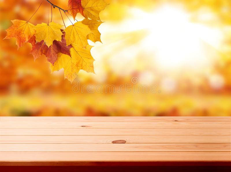 Wood table top on shiny bokeh gold background - can be used for display or montage your products royalty free stock photo
