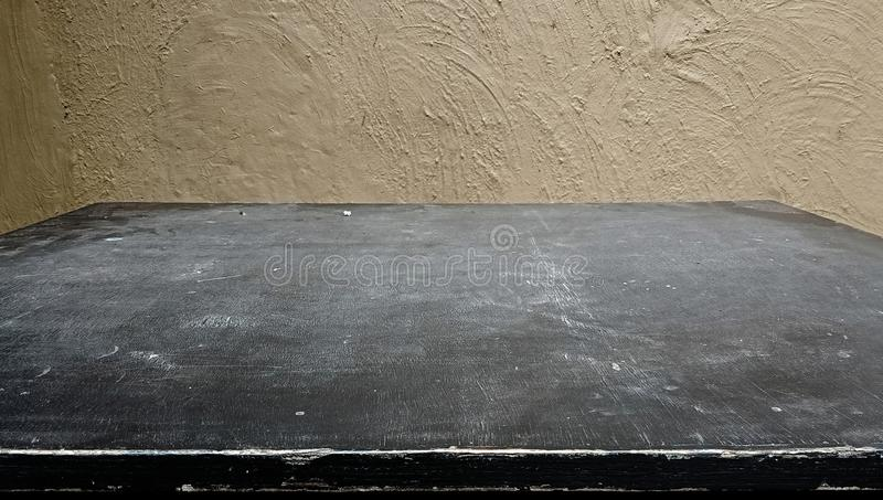 Wood table top with wall textured background. A black wood blur background. can be used for display or Business, defocused. royalty free stock images