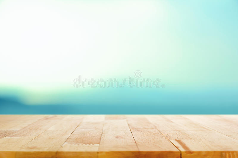 Wood table top on white blue gradient background. Can be used for montage & display your porducts on top royalty free stock images