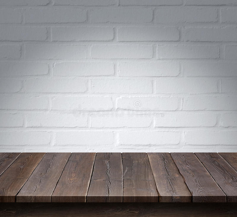 Wood table with White brick wall background royalty free stock photo