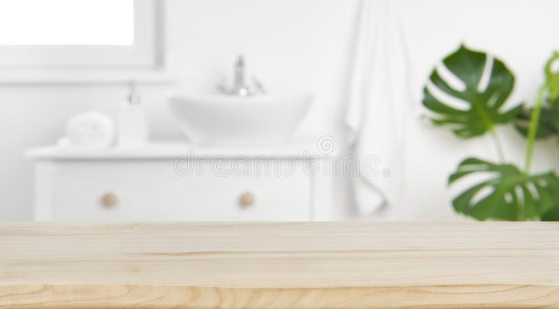 Wood tabletop on blur bathroom background, design key visual layout.  royalty free stock images