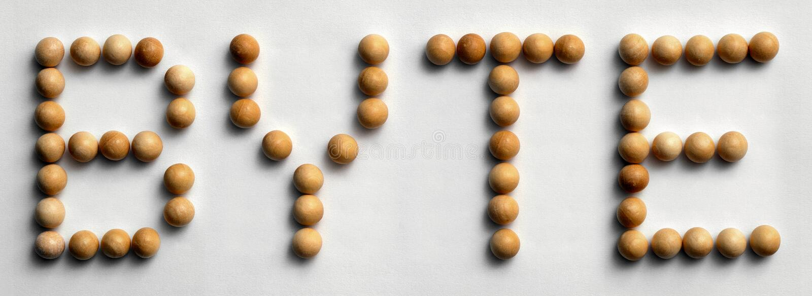 Wood Tack Word Art `Byte`. Photograph of the word `Byte` spelled out with wood push pins royalty free stock photo