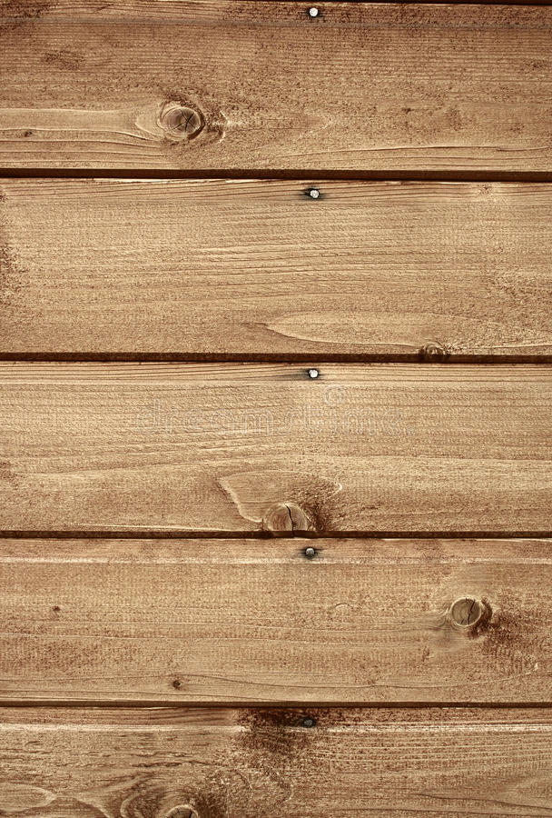 Wood texture. Abstract background / backdrop representing fragment of a wooden house wall with nails and wood surface texture. Portrait orientation. The image stock photo