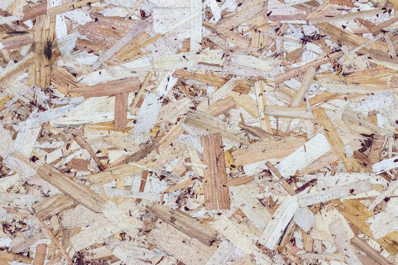 Wood texture background. pressed sawdust. OSB boards are made of wood chips. Top view of OSB wood background. Wood texture background. pressed sawdust. OSB royalty free stock images