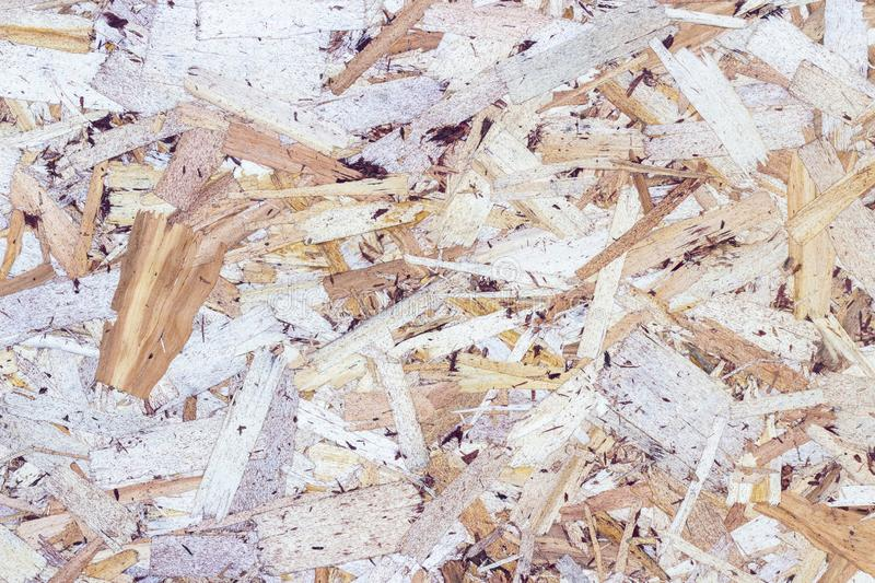 Wood texture background. pressed sawdust. OSB boards are made of wood chips. Top view of OSB wood background. Wood texture background. pressed sawdust. OSB stock photography