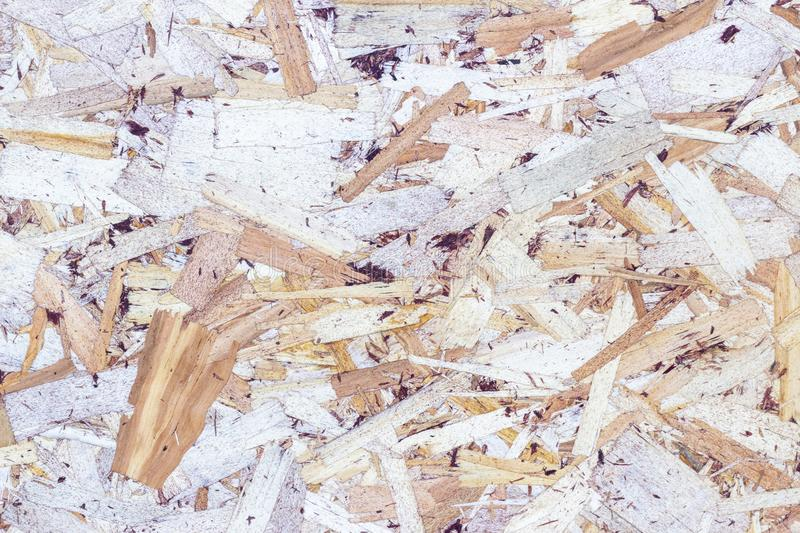 Wood texture background. pressed sawdust. OSB boards are made of wood chips. Top view of OSB wood background. Wood texture background. pressed sawdust. OSB royalty free stock photos