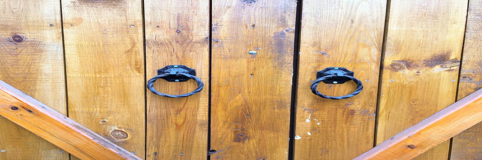 Wood texture background, wood door planks. Old washed wood door pattern top view. Close up on ancient wood door. Wood texture background, wood door planks. Old royalty free stock photos