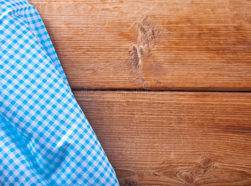Wood texture background. Wooden table covered with blue tablecloth. View from top. Empty tablecloth for product montage for stock images