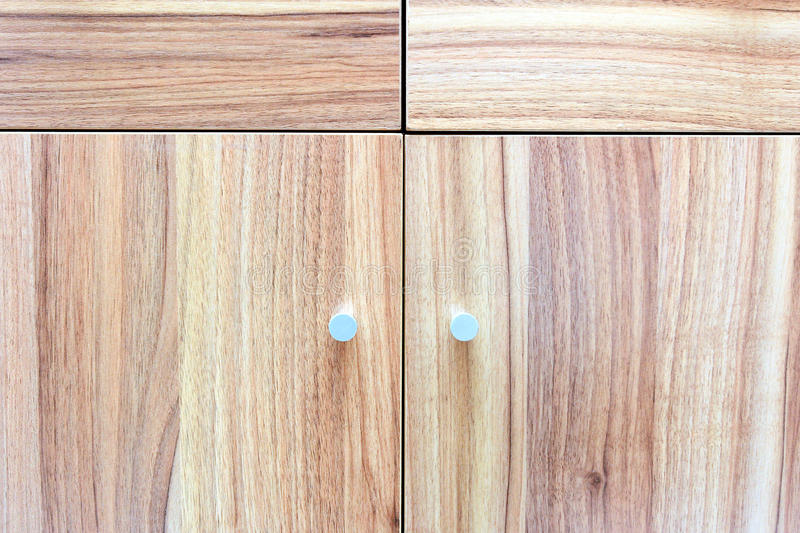Wood texture on cupboard.Different lines direction create a pattern. Object that can be found inside a house stock photo