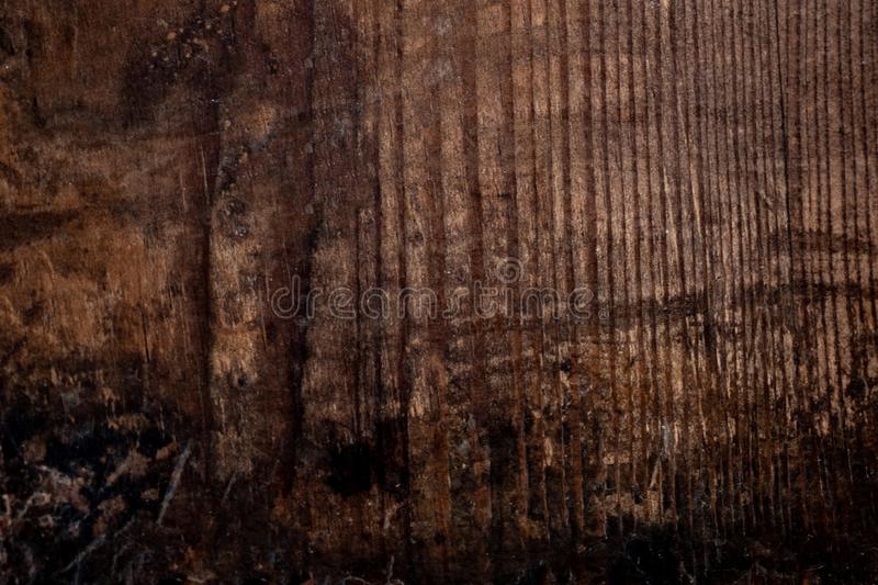 Wood texture, Dark Brown scratched wooden cutting board. Natural royalty free stock images